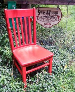 Red Chair by Swiss Woods sign