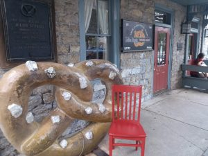Red Chair by giant soft pretzel sign
