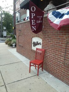Red Chair by open sign