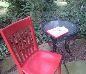 Red Chair at an outside table