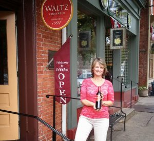 Kim Waltz showing off one of their amazing wines.
