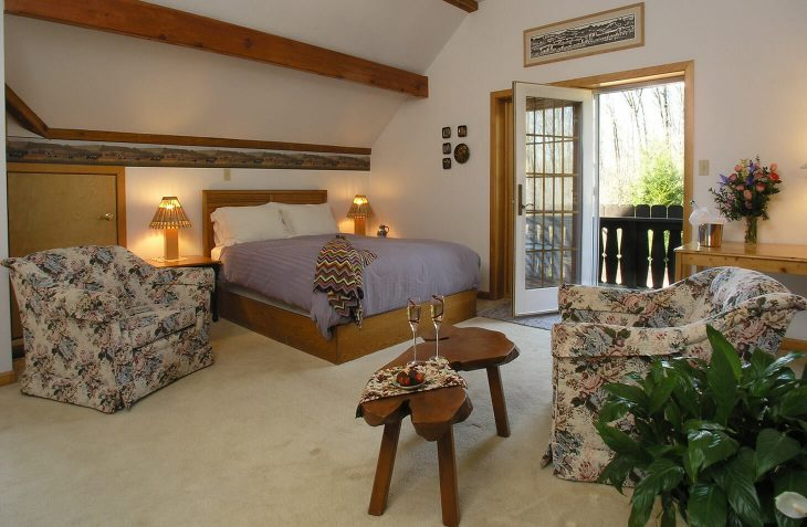 Appenzell Room with bed and chairs at our Lancaster County bed and breakfast