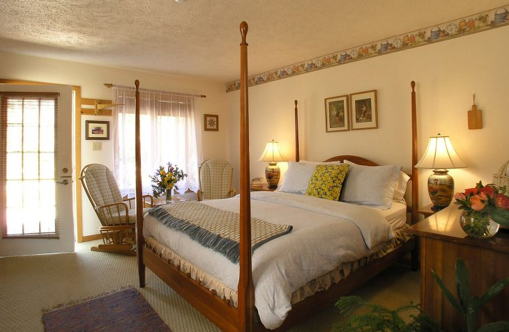 Emmental Room four poster bed and seating area at our Lancaster, PA B&B