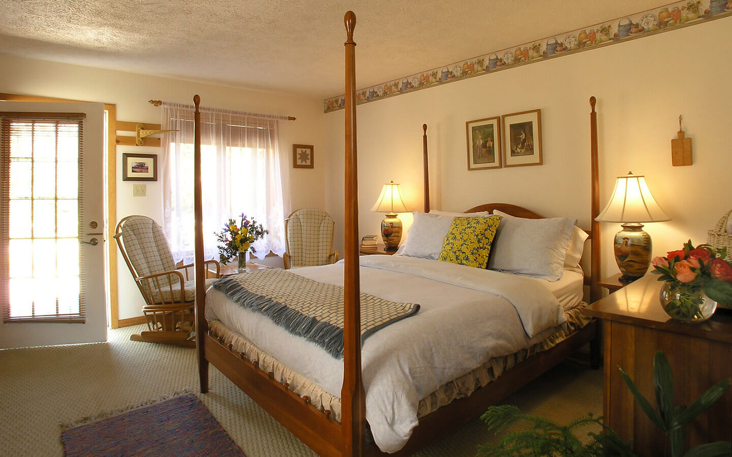 Emmental Room four poster bed and seating area at our Amish Country B&B