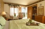 Lugano Room bed and seating area at our Lancaster County bed and breakfast