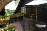 Matterhorn Suite deck with table at our Lancaster County bed and breakfast