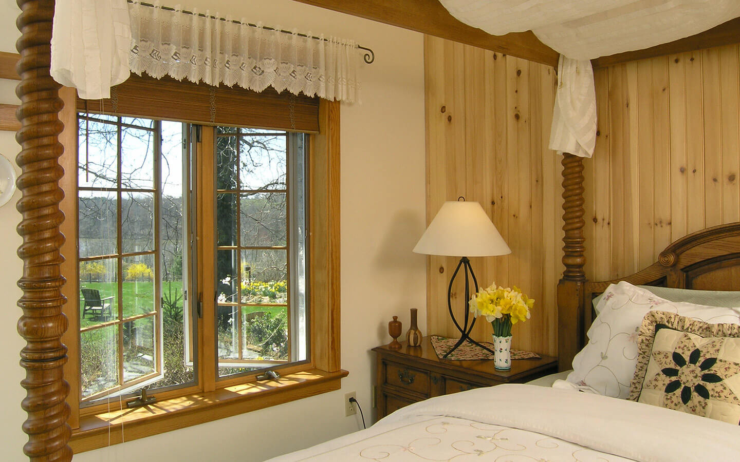 San Bernadino Room four poster bed and window view at our Lancaster County PA B&B