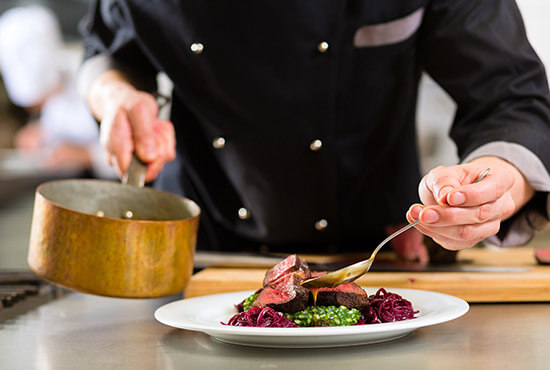 Chef preparing a plate of food at a restaurant in Lancaster County PA
