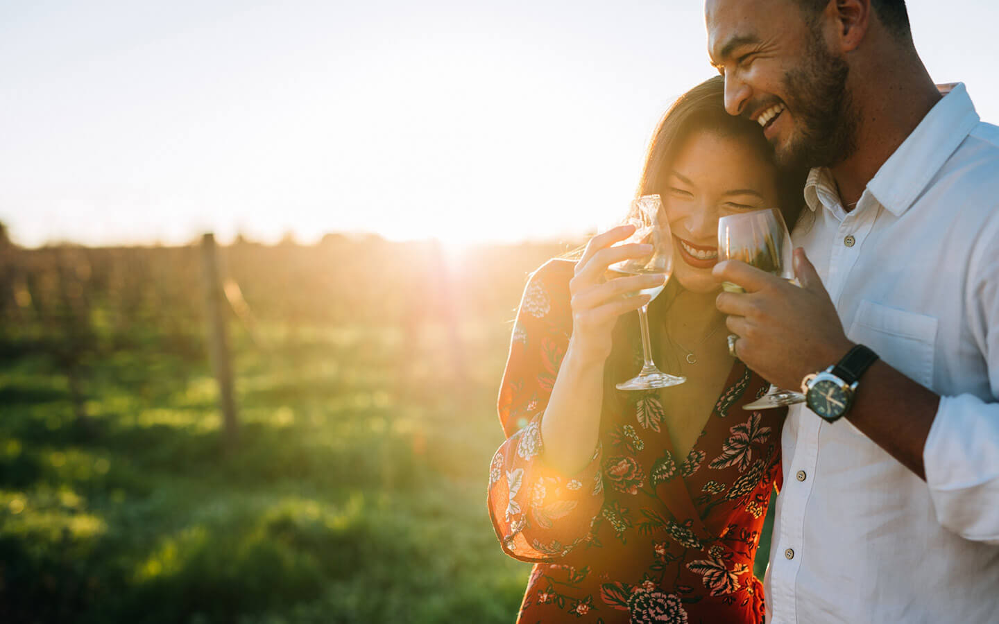 Couple with wine at a winery in Lancaster County