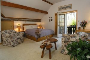 Appenzell Room with bed and seating area at our Lancaster County bed and breakfast