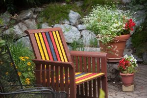 Colorful chair next to flowers at our Amish Country bed and breakfast