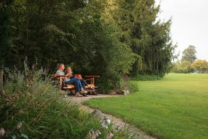 Couple sitting on a bench admiring the garden at our at our Lancaster County B&B