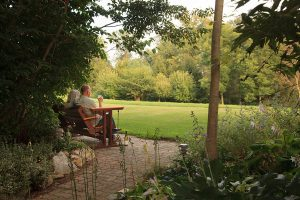 Couple sitting on a bench in the garden at our Amish Country, PA B&B