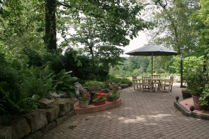 Patio with chairs and table in the garden at our Amish Country, PA bed and breakfast
