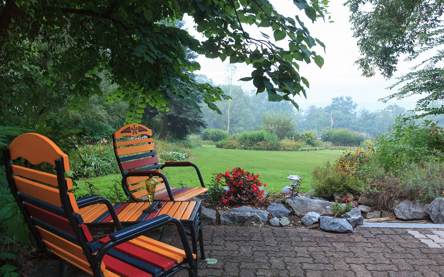 Two chairs on a patio in the garden at our Amish Country bed and breakfast