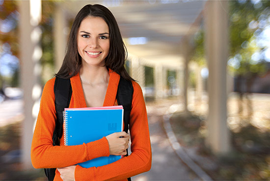 Teenage girl holding notebooks for school at Linden Hall