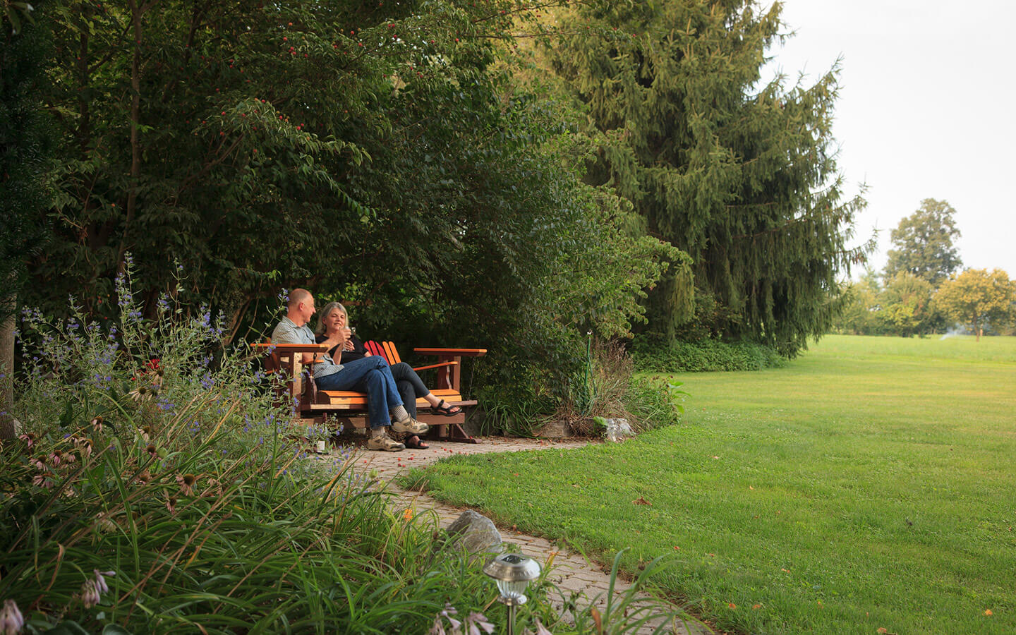 Couple sitting outside drinking wine during a Lancaster, PA romantic getaway