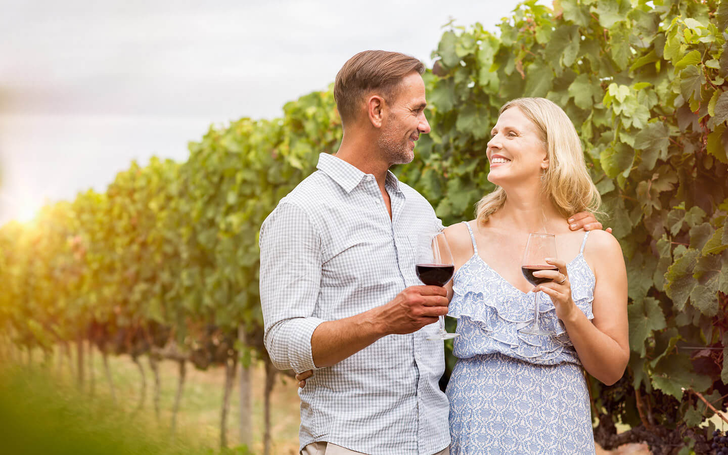 Happy couple with wine at a vineyard in Lancaster County