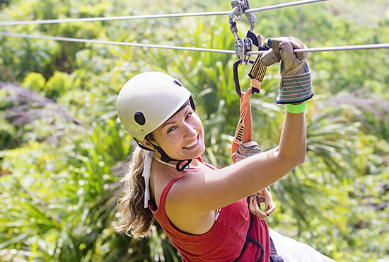 Smiling woman on a zipline in Lancaster County