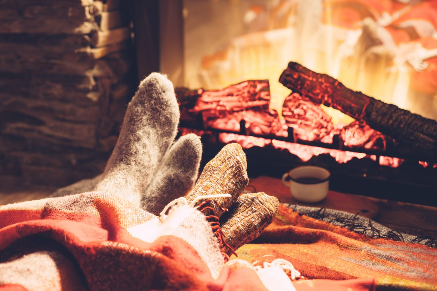 Cozy up by the fire place during your fall getaway at Swiss Woods